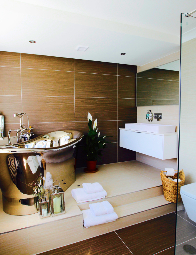 Chrome bathtub in main bathroom